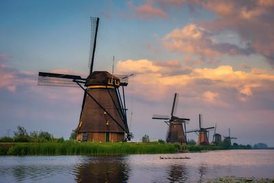 Sunset above old dutch windmills in Kinderdijk, Netherlands