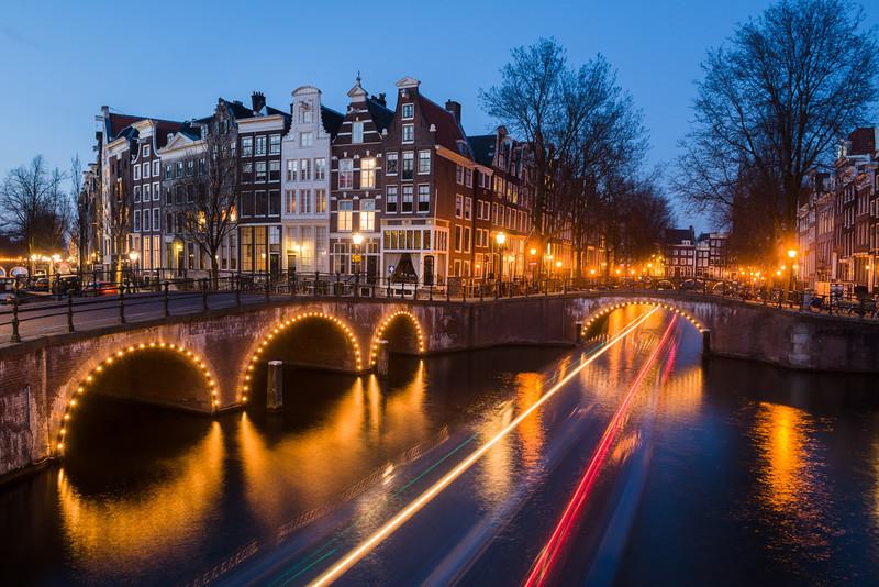 Amsterdam twilight with boat tracks