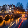 Amsterdam twilight with boat tracks