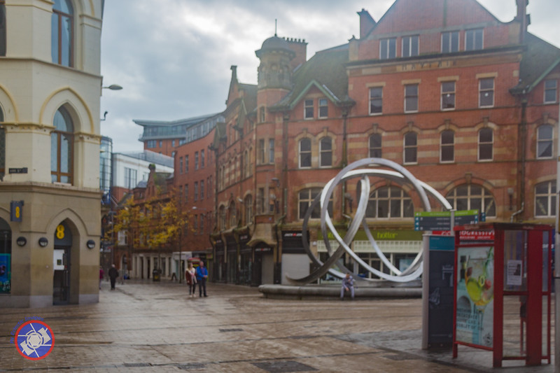 The Cornmarket, Also Known as Arthur Square and the Spirit of Belfast Sculpture (Affectionately Known as the Onion Rings) Close to the Location of the Abercorn Bar - the Site of a Fatal Bombing in March 1972 (©simon@myeclecticimages.com)