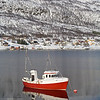 Kaldfjork with red fishing boat
