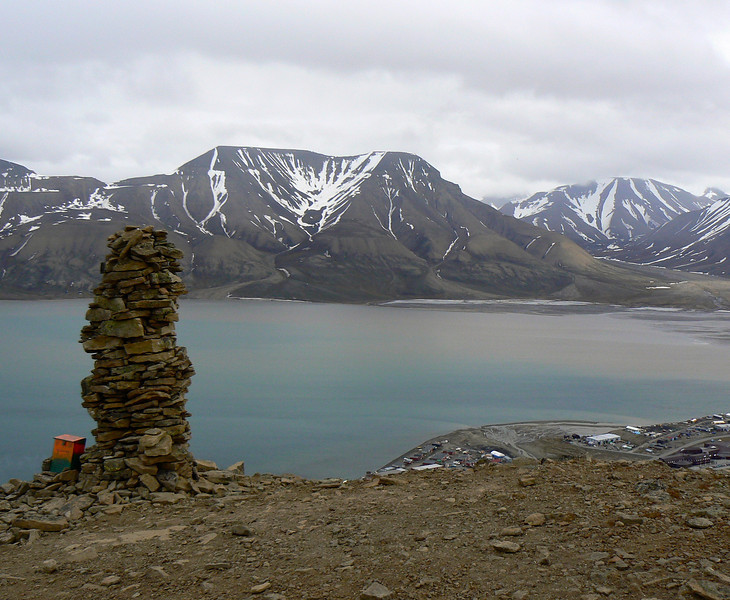 We reach the cairn on a hike up Plateau Mountain in Longyearbyen, Norway