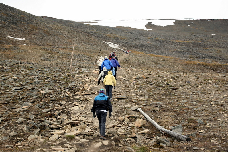 Hiking Plateau Mountain on a cruise excursion in Longyearbyen , Norway