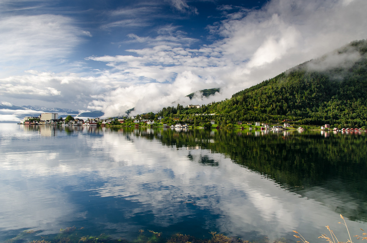 Balestrand with mist, clouds and sunshine as seen from Dragsvik.