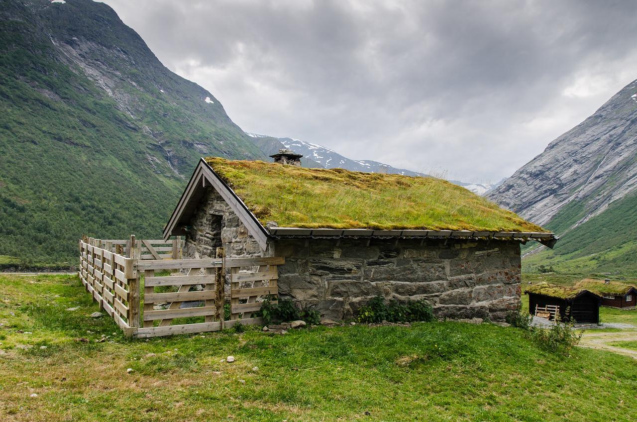 Small sod roofed barn.