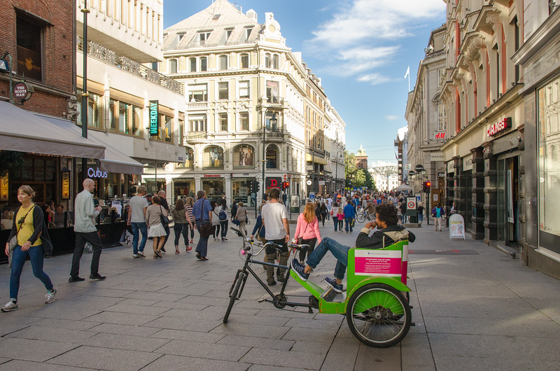 A pedicab driver waits in Oslo's shopping district.