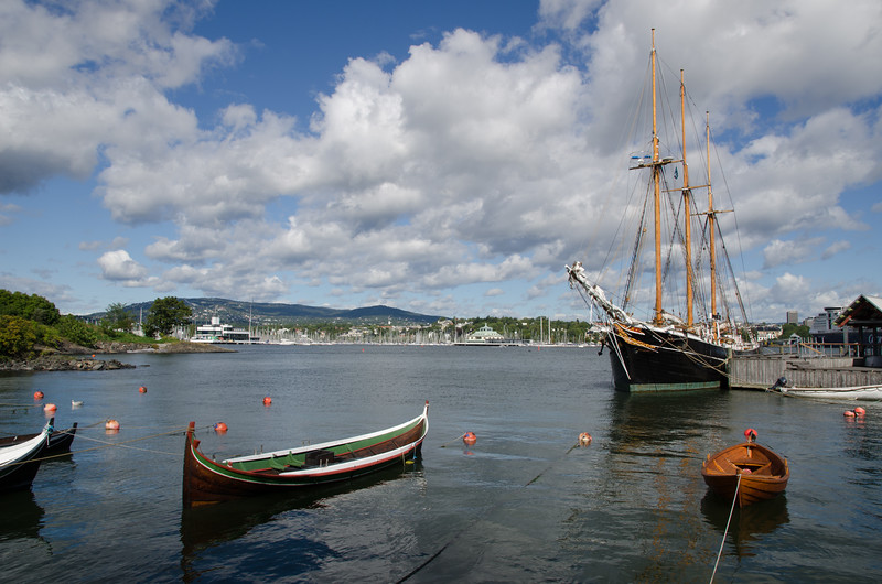 Small boats in the foreground with the three master schooner Svanen (1916) in the background.