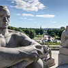 A view of Vigeland Park with sculptures in the foreground.
