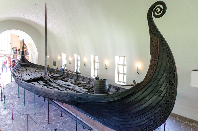 "The Oseberg Ship - 820 AD<br /> Found in Slagen, Vestfold, Norway in a large burial mound.<br /> <br /> The Oseberg ship is the oldest clinkerbuilt ship with certain rig known in Scandinavia so far. It represents an early type of Viking ships, built shortly after the introduction of sail and rig in Scandinavia. It is shorter than the longships which were built in the 10th century and on. The Oseberg ship is determined to belong to the Viking ship class called ""karv"" (old norse ""karfi"")."