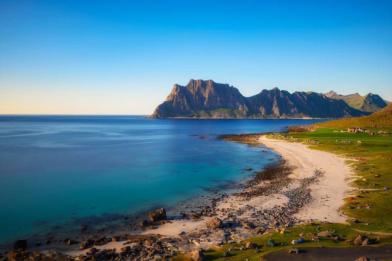Many tents and camping cars on Uttakleiv beach in Lofoten islands, Norway