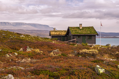Cabin with turf roof near Hardangervidda National Park in Norway