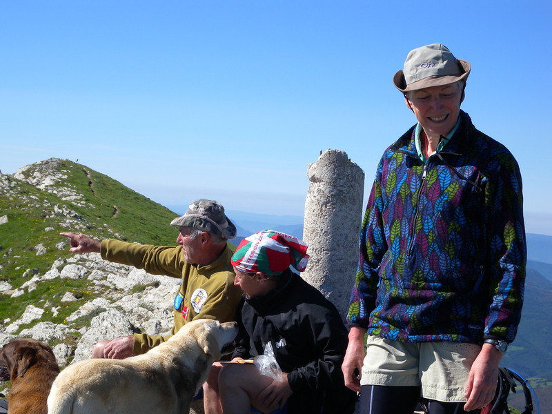 Enthusiastic Basque hiking couple from Bayonne, with their two dogs on the summit of Pic d'Orhy.