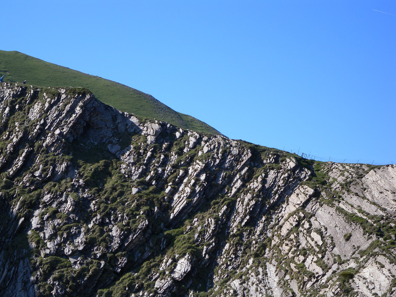 Nearing the summit. Walkers in the top left; fence on the ridge to the right.