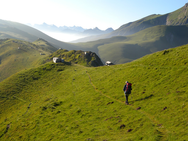 Passing shooters' huts on the ridge.