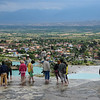 People walking in the pools and enjoying the view