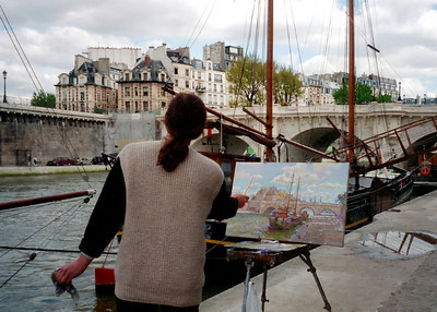 Artist Painting a Paris Scene Along The Seine River