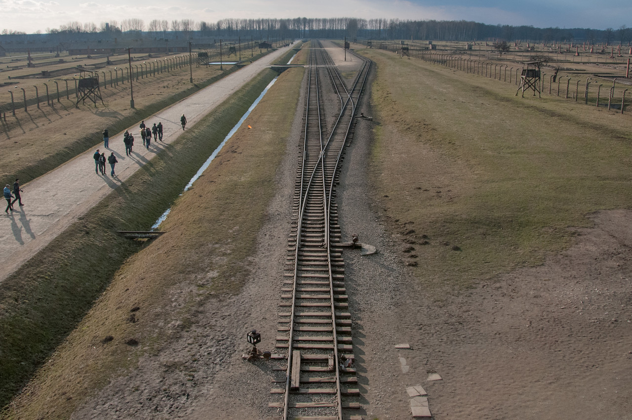 Looking down at the railway track leading to main gate at Auschwitz Birkenau in Poland