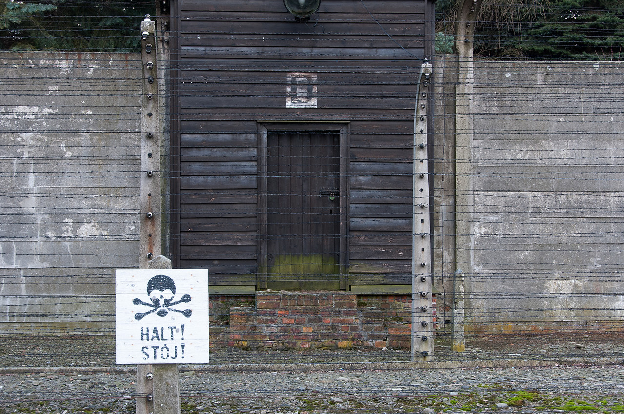 Warning sign outside the guard tower in Auschwitz Birkenau in Poland