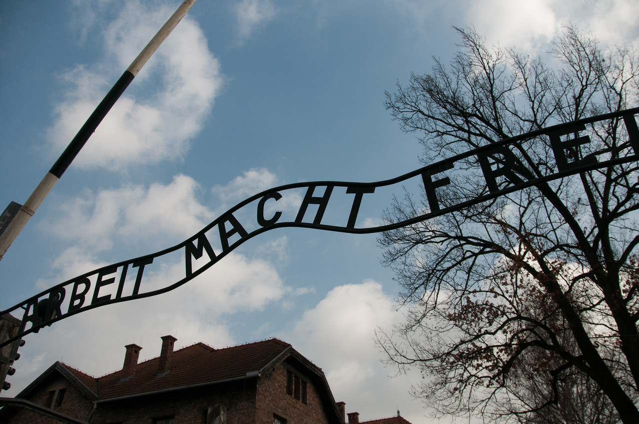 Looking up the entrance gate to Auschwitz Birkenau in Krakow, Poland