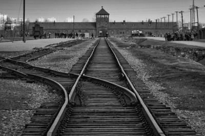 The main gate to Auschwitz Birkenau in B&W - Krakow, Poland