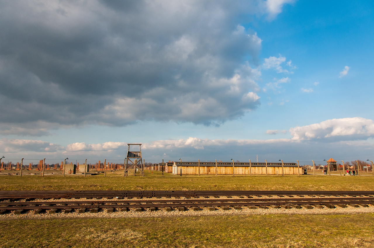 Wide shot of the railway track and concentration camp in Auschwitz Birkenau in Poland