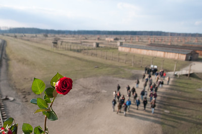 Tourists on site at hte Auschwitz Birkenau concentration camp in Poland