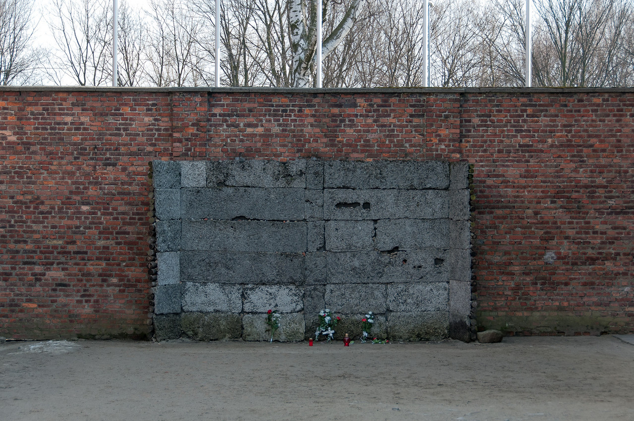 Memorial next to brick wall in Auschwitz Birkenau in Poland