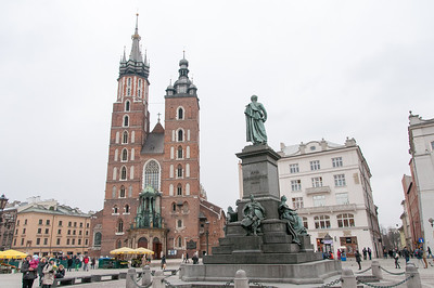 St. Mary's Church and Adam Mickiewicz monument in Market Square - Krakow, Poland