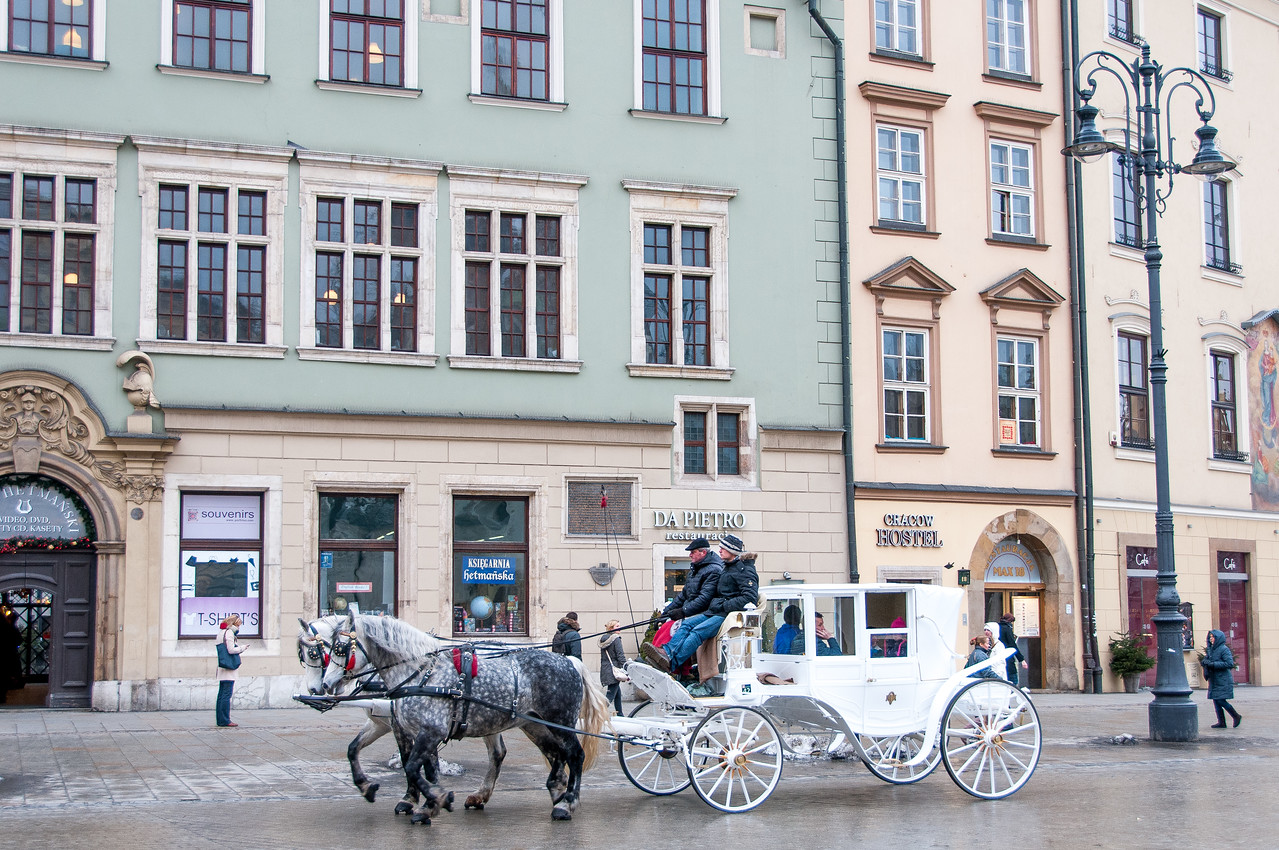 Horse carriage in the main market square of Krakow, Poland