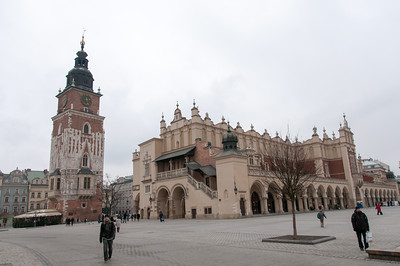The Town Hall Clock Tower and the southern end of the Cloth Hall Building in the Market Square - Krakow, Poland