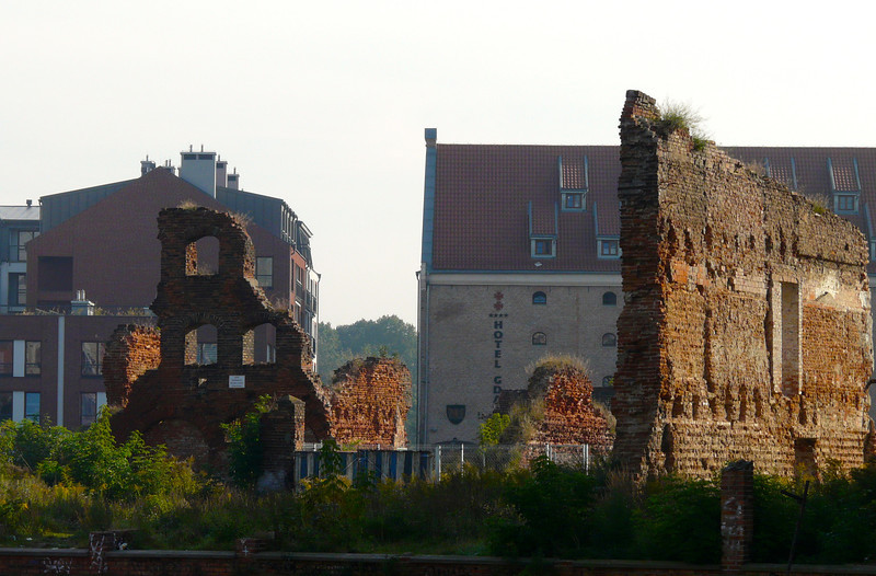 Looking through crumbling ruins to modern Gdansk.