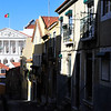 Our Lisbon apartment (right side with sunshine on the balcony) - view looking down the street to the Parliament building