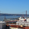 Overlooking the roof tops and river in Lisbon