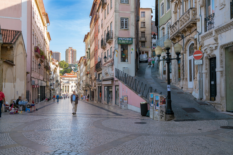 People on the streets of Coimbra in the morning.