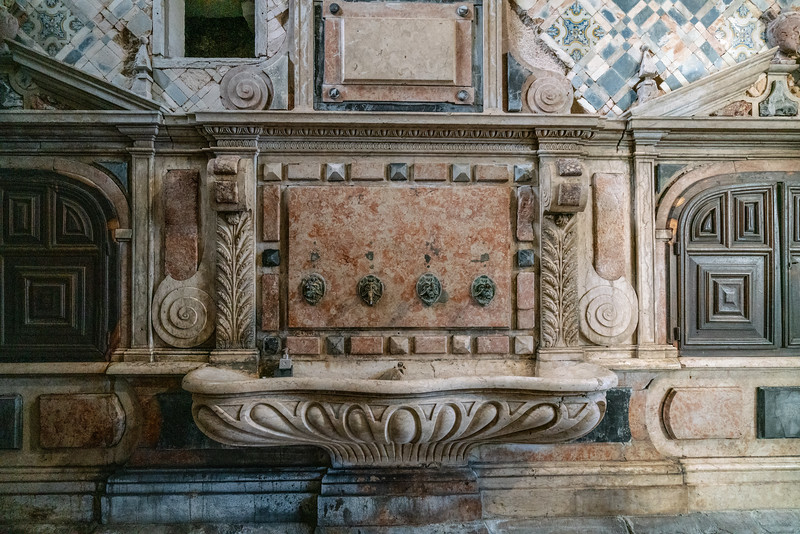 An old drinking fountain in the Mosteiro de Santa Cruz.