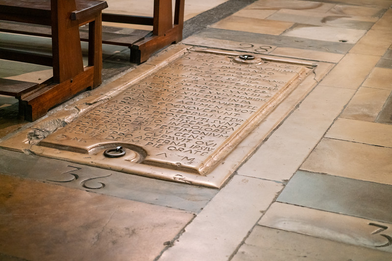 Tomb in the floor of the Church of Santa Cruz.