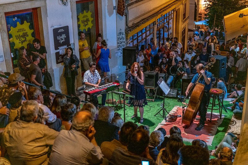 The steps become a grandstand for a jazz show in Coimbra.