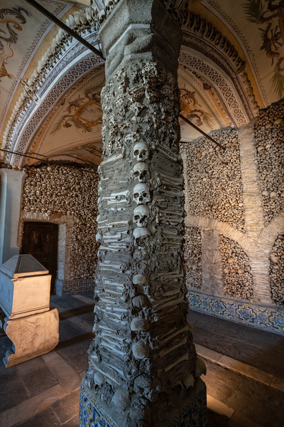 The bone chapel is the work of three monks who were concerned about society's values at the time. They thought this would provide Evora, a town noted for its wealth in the early 1600s, with a helpful place to meditate on the transience of material things in the undeniable presence of death.