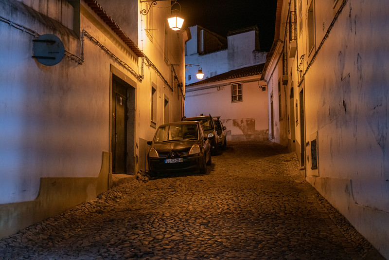A lonesone steep street in Evora.