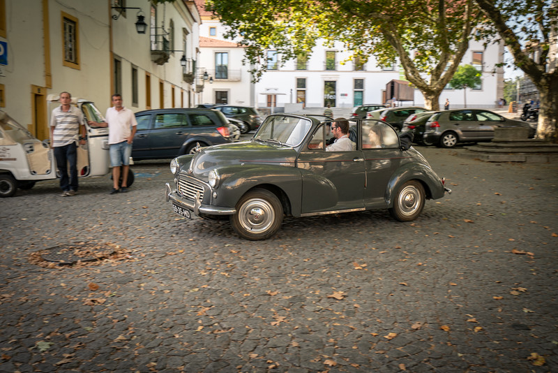 A Morris Minor putting around Evora.