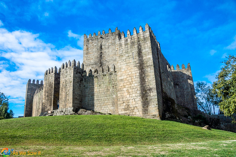 Side view of Guimaraes Castle on grassy hill