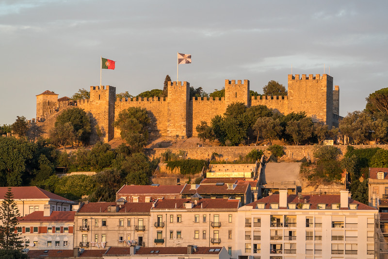 São Jorge Castle illuminated by the setting sun from my terrace.