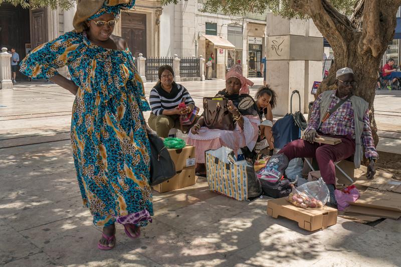 African immigrants in front of Igreja de São Domingos.