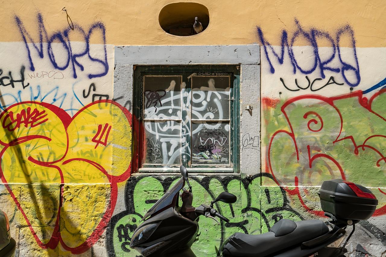 Graffiti on a wall in Bairro Alto.