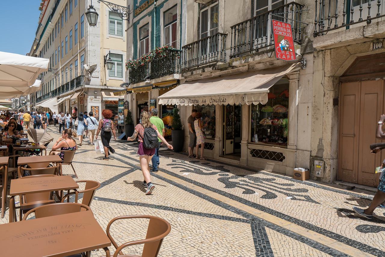 A pedestrian street in the Baixa neighborhood. Note the typical calcada paving.