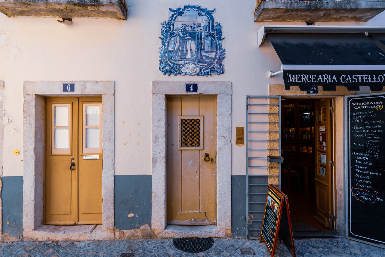 Some tiny charming shops and houses in the Castle Town. The tilework above the door is traditional.