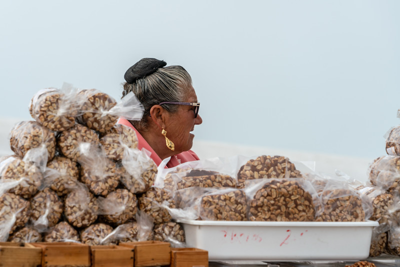 Woman selling treats in Sitio.