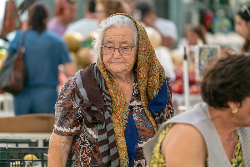 An old lady shopping in Nazare.