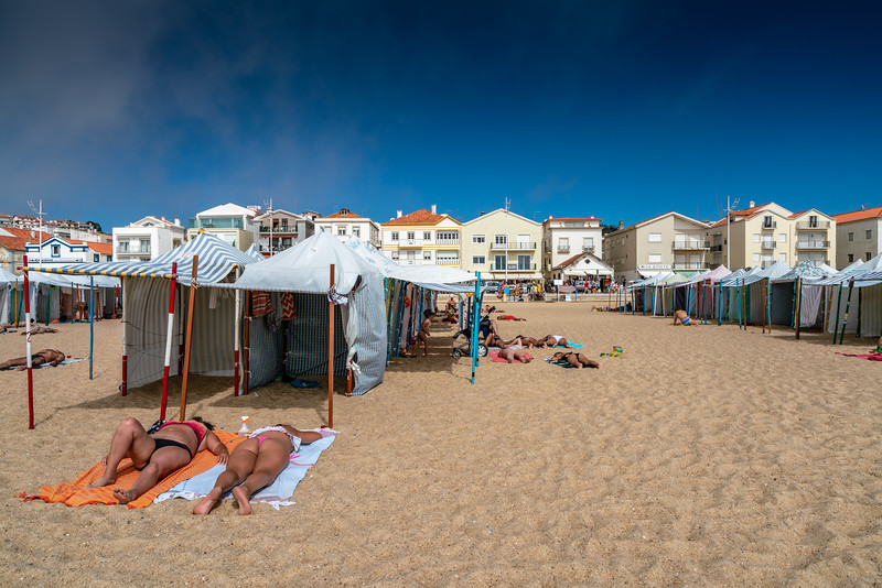 People enjoying the beach in Nazare.
