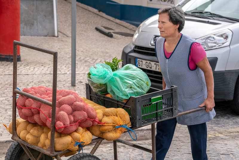 A woman delivering produce to restaurants in Nazare. You have to look pretty hard to find men doing any work.
